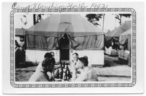 Primary view of object titled 'Soldiers at table outside tent 1942'.