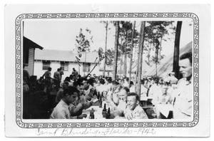 Primary view of object titled 'Large group of soldiers eating Camp Blandin 1942'.