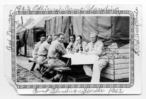 Primary view of object titled 'Seven Officers at table- Camp Blanding 1942'.