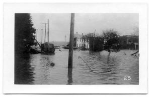 Primary view of object titled '[Photograph of Flood Waters Around Old Winona Hotel]'.