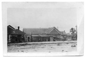 [Photograph of House and Sand Bank]