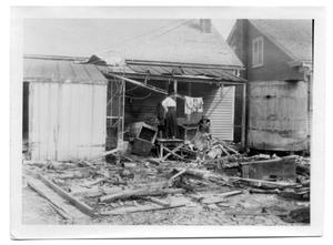 Primary view of object titled '[Photograph of Mrs. Hendrix Porch After Hurricane]'.