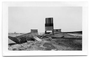 Primary view of object titled '[Photograph of Destroyed Causeway and Railoroad Bridge]'.