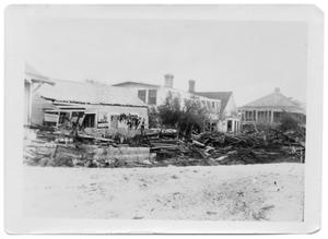 Primary view of object titled '[Photograph of Houses and Debris on Water Street]'.