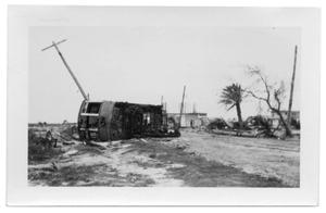 Primary view of object titled '[Photograph of Streetcar Overturned in Road]'.