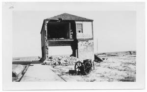 Primary view of object titled '[Damaged two-story building]'.