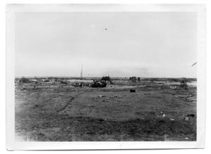 Primary view of object titled '[Cars overturned on the beach]'.