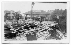 Primary view of object titled '[Photograph of Magnolia Petroleum Co. and Hurricane Debirs]'.