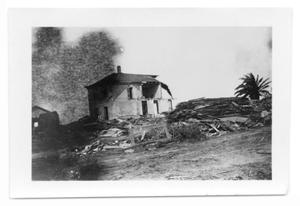 Primary view of object titled '[Photograph of Old Seaside Hotel and Debris]'.