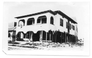 Primary view of object titled '[Photogrpah of W.W. Chapman Apartments After Storm]'.