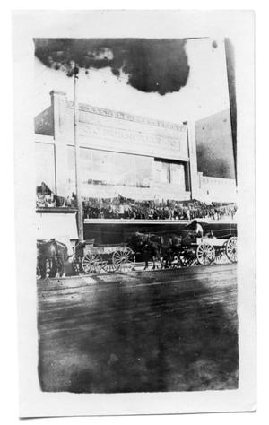 Primary view of object titled '[Photograph of Goods Drying Outside Furniture Store]'.