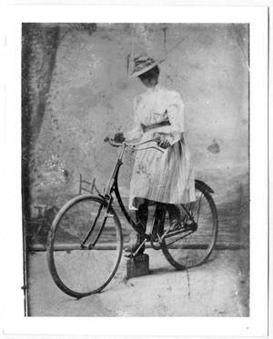 Primary view of object titled '[Caroline McGuire Street, posing on a bicycle]'.
