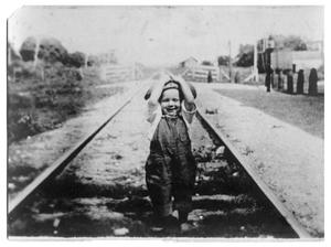 Primary view of object titled '[Unidentified Child on Railroad Tracks]'.
