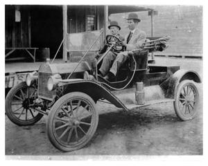 Primary view of object titled '[Dr. Tucker and Dr. Linder in a 1911 Model T Ford]'.