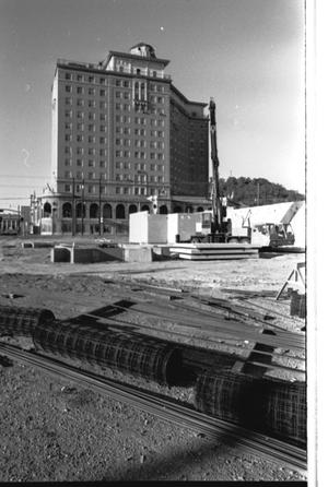 Primary view of object titled '[The Construction Site of the Mineral Wells Savings and Loan, 1 of 3, The Baker Hotel is in the Background]'.