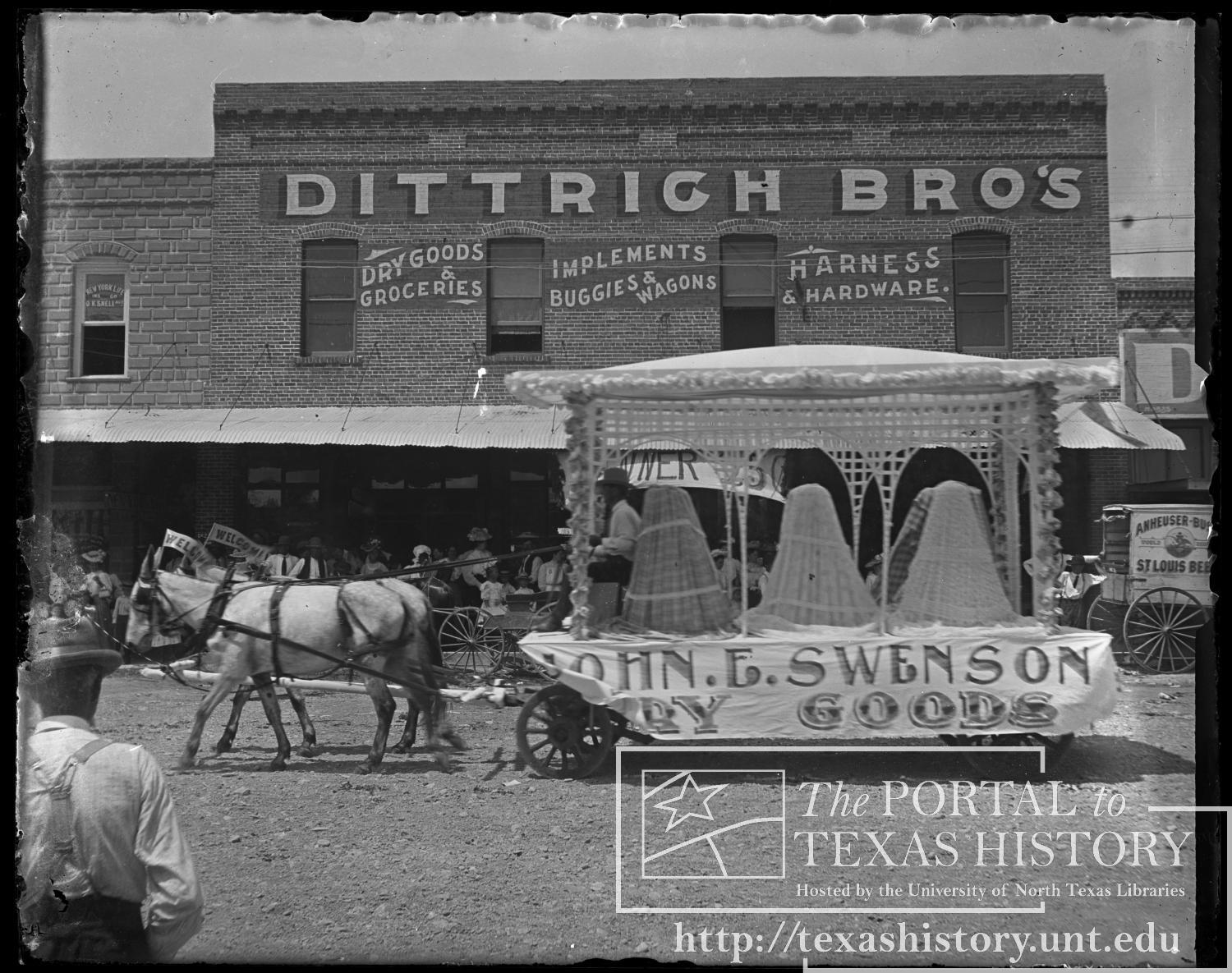 Parade Float: John E. Swenson, Dry Goods                                                                                                      [Sequence #]: 1 of 1