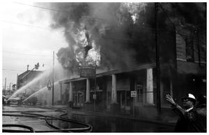 Primary view of object titled '[The Damron Hotel Fire, 18 of 21:   Individual in Front of the Burning Hotel]'.