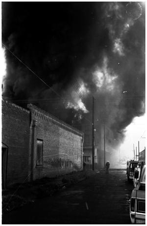 Primary view of object titled '[The Damron Hotel Fire, 17 of 21:   Two Individuals on the Street Northwest of the Fire]'.