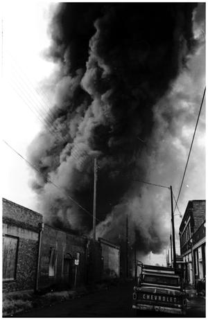Primary view of object titled '[The Damron Hotel Fire, 16 of 21:  Black Smoke Billowing Over Businesses]'.
