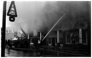 Primary view of object titled '[The Damron Hotel Fire, 13 of 21:  Christmas Decorations on Light Poles]'.