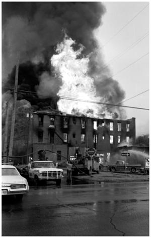 Primary view of object titled '[The Damron Hotel Fire, 4 of 21, Fire Inside the Structure]'.