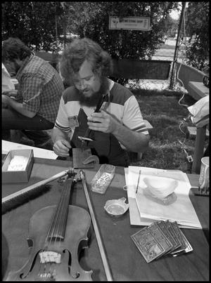 Primary view of object titled '[Steve Hartz Repairing Violin]'.