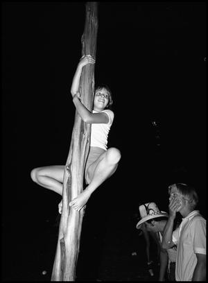 Primary view of object titled '[Girl Climbing Belgian Mast]'.