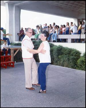 Primary view of object titled '[Jim and Mary Hebert Dancing While The Cajun Band Performs]'.