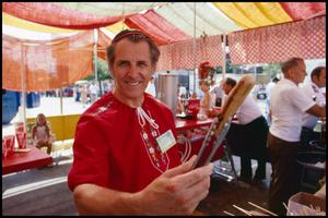 Primary view of object titled '[Hans Nadler in Swiss Food Booth]'.