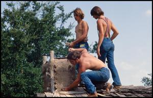 Primary view of object titled '[Three Shirtless Men on a Roof]'.