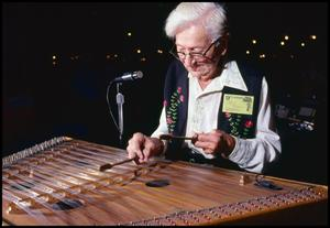 Primary view of object titled '[Ray Baca Playing the Hammer Dulcimer]'.