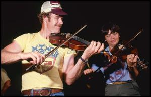 Primary view of object titled '[Gene and Mary Nell Young Playing Violin]'.