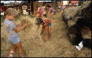 Primary view of object titled '[Children Playing in the Hay in Frontier Playland]'.