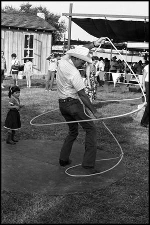 Primary view of object titled '[Bruce Montague Demonstrating Trick Roping]'.