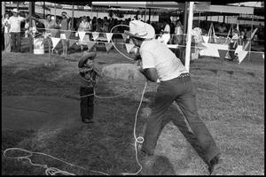 Primary view of object titled '[Bruce Montague Lassoing a Small Boy]'.