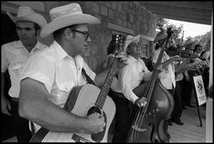Primary view of object titled '[Lone Star Fiddlers Playing on the Porch of Frontier Fort]'.