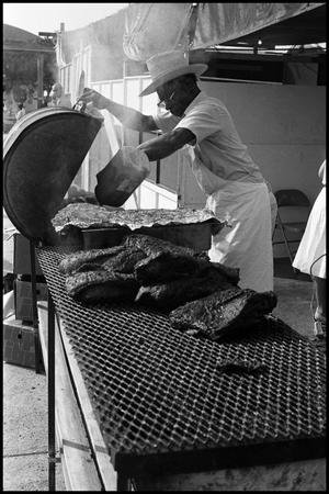 Primary view of object titled '[Man Making Barbecue]'.