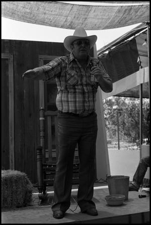 Primary view of object titled '[Ace Reid on Storytelling Stage]'.