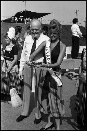 Primary view of object titled '[Miss Texas USA Cutting Ribbon at Opening Ceremony]'.