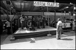 Primary view of object titled '[Musicians Performing on Irish Stage]'.
