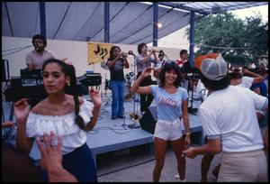 Primary view of object titled '[Visitors Dancing to Tejano Music]'.