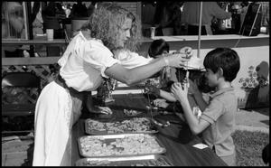 Primary view of object titled '[Making Pasta Necklaces in the Italian Booth]'.