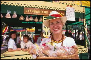Primary view of object titled '[Madalyn Yezdauski at the Lithuanian Booth]'.