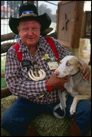 "Primary view of object titled '[Virge T. ""Cowboy"" Williams and His Hog Dog]'."