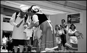 Primary view of object titled '[Italian Tarantella Dancers at the Texas Folklife Festival]'.
