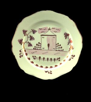 Primary view of object titled 'Pink lusterware plate'.