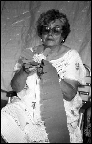 Primary view of object titled '[Guadalupe De Pena Making Paper Flower]'.