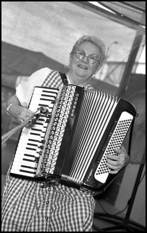 Primary view of object titled '[Accordionist for Wurstfest Opa Band]'.