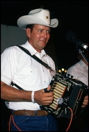 Primary view of object titled '[Accordion Player in Joe Simon Cajun Band]'.