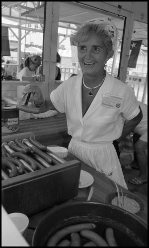 Primary view of object titled '[Grete Benedict selling hotdogs]'.